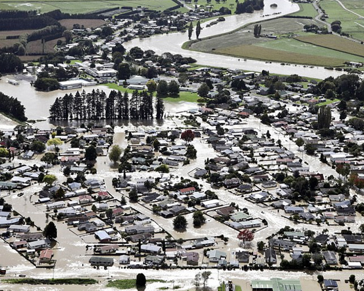 The North Island town of Edgecumbe in New Zealand, Thursday, April 6, 2017. About 2,000 residents needed rescuing after the river burst through a concrete levee, flooding hundreds of homes and businesses. Photo: AP